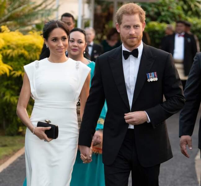Le prince Harry et Meghan Markle enceinte lors d'une réception à la Maison consulaire de Tonga, le 25 octobre 2018