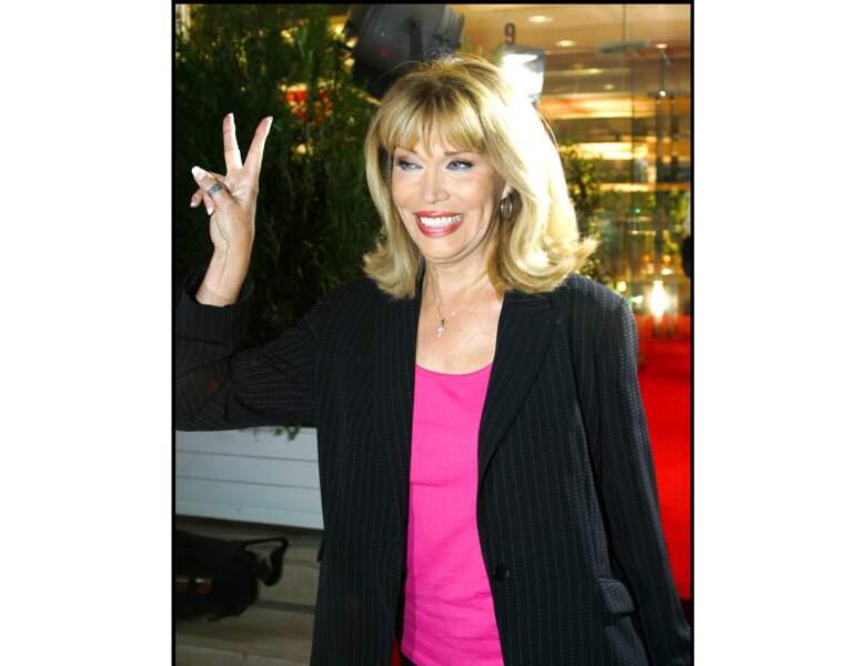 En 2003, elle porte du gloss très à la mode !