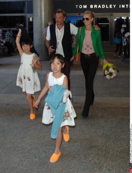 Johnny et Laeticia Hallyday avec leurs filles Jade et Joy