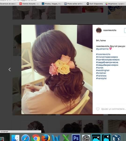 Coiffure de mariage pour cheveux longs : chignon oversize et roses