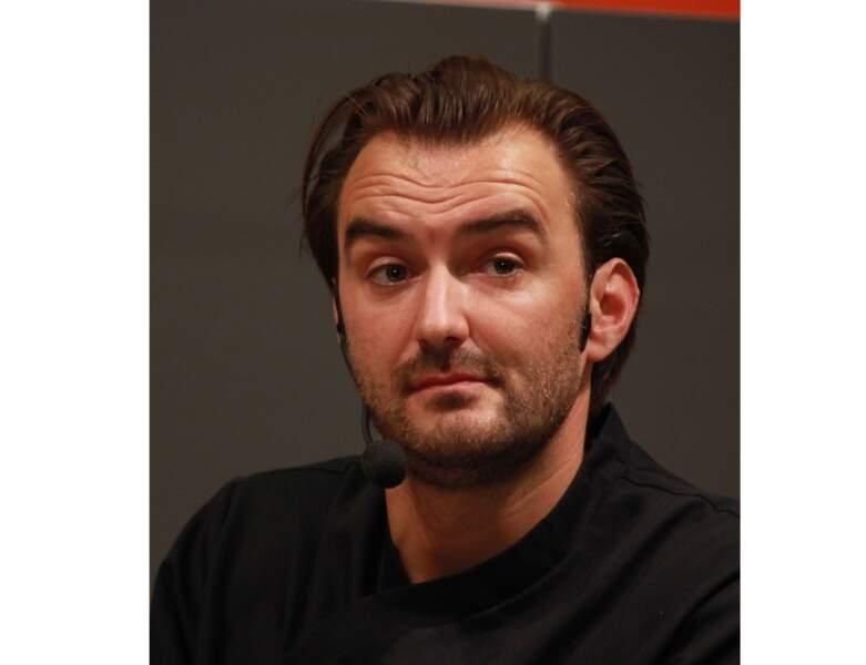 En 2011, il combine cheveux gominés et barbe