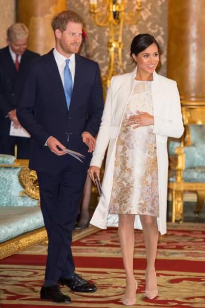 Le prince Harry et Meghan Markle enceinte lors de l'investiture du prince de Galles à Londres, le 5 mars 2019