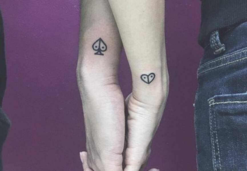 Tatouages couple coeur et pic