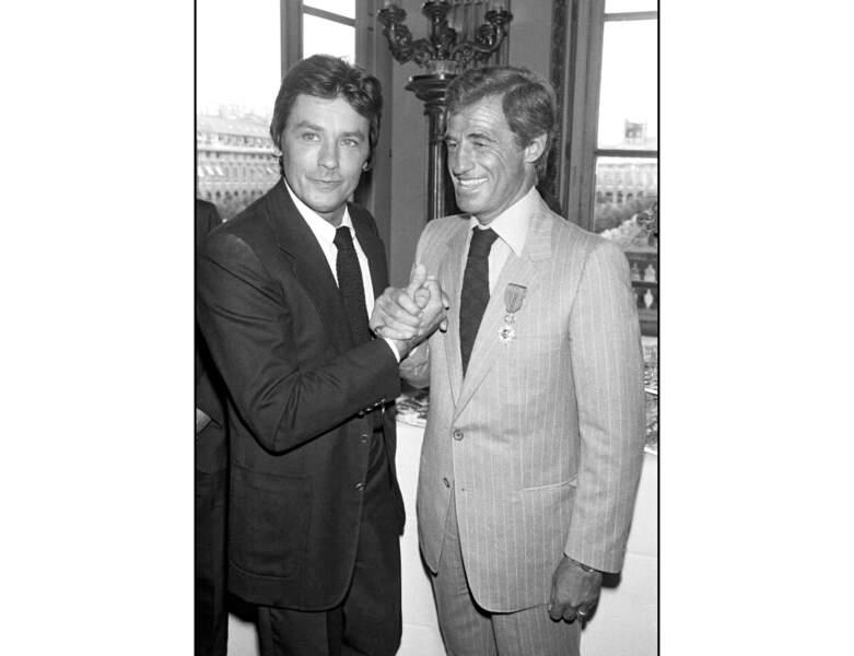 En 1980, il pose avec l'acteur Jean-Paul Belmondo