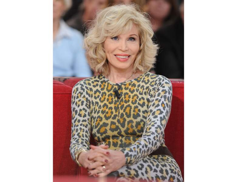 2012 : ses boucles glamour et sauvages s'accordent avec son look
