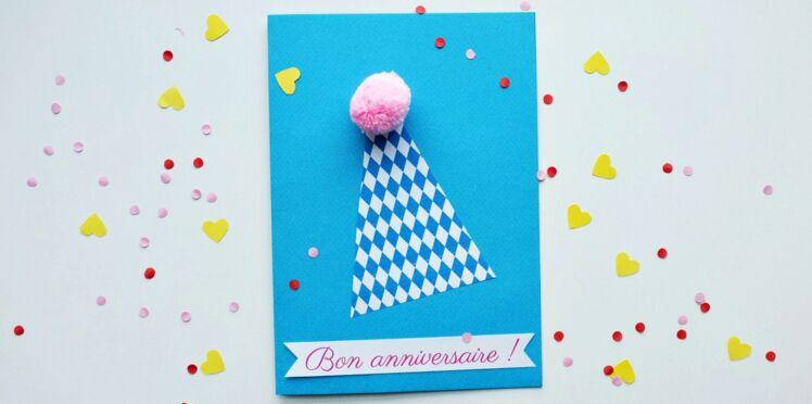 Une carte d'anniversaire avec un pompon
