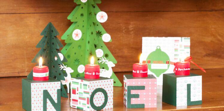 Déco de Noël : des cubes décorés en guise de bougeoirs