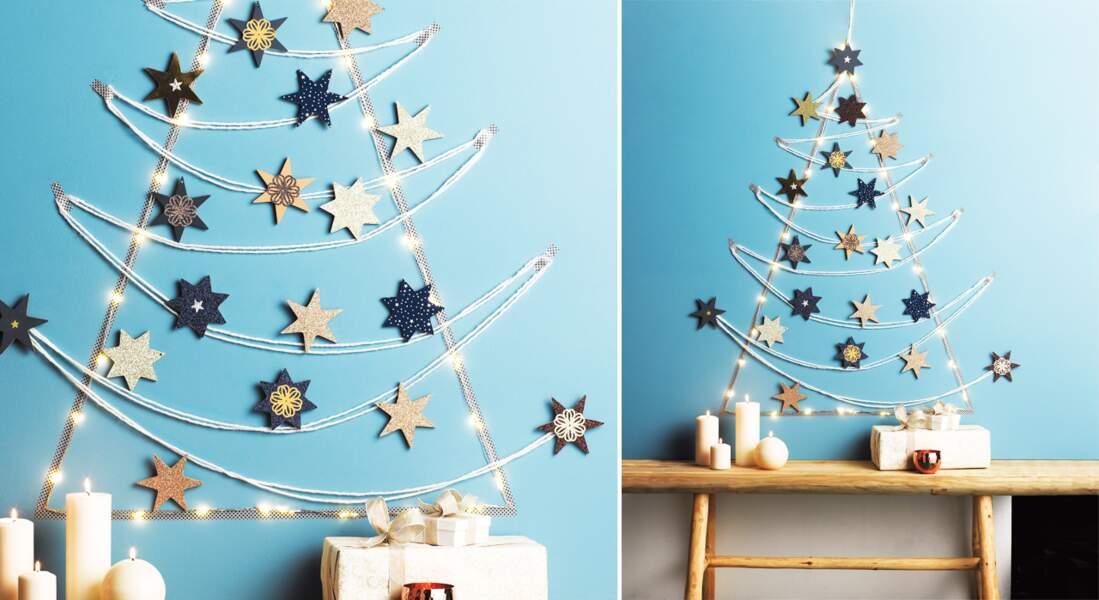 Un sapin de Noël mural et étoiles en papier