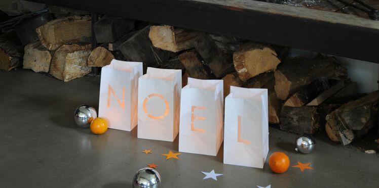 Des sacs en papier découpés comme photophores de Noël