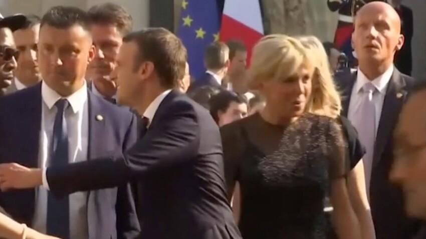 Brigitte Macron paniquée lorsqu'un homme alpague Emmanuel Macron dans la cour de l'Elysée