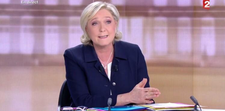 Que représente le pendentif de Marine Le Pen ?