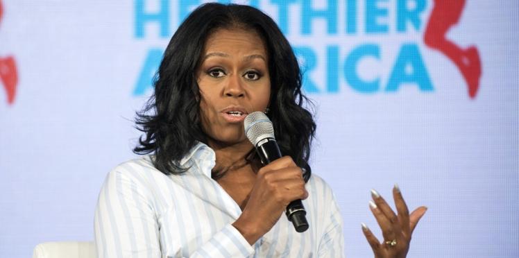 Pour la fête des pères, Michelle Obama publie un adorable cliché ancien de Barack et ses filles