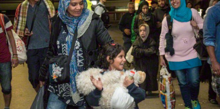 Des réfugiés accueillis par des applaudissements en Allemagne