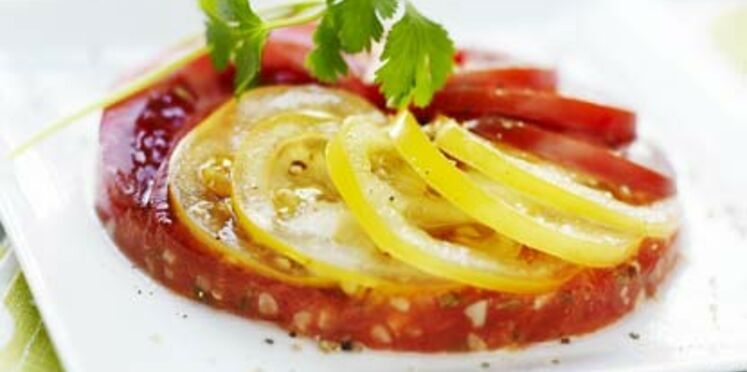 Carpaccio de tomates multicolores, cumin et coriandre fraîche
