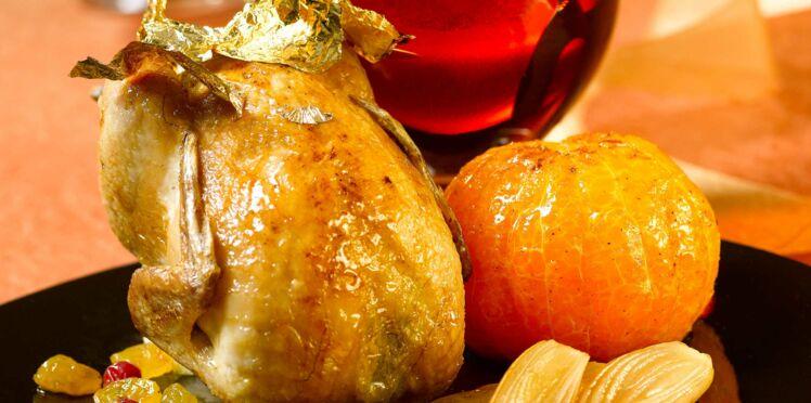 Cailles rôties farcies aux clémentines, airelles et raisins