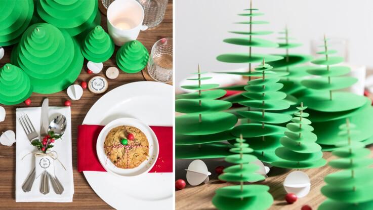 Un centre de table de Noël avec des sapins en papier
