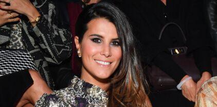 371978e9932 Karine Ferri rayonnante en petite robe noire   elle dévoile ses ...