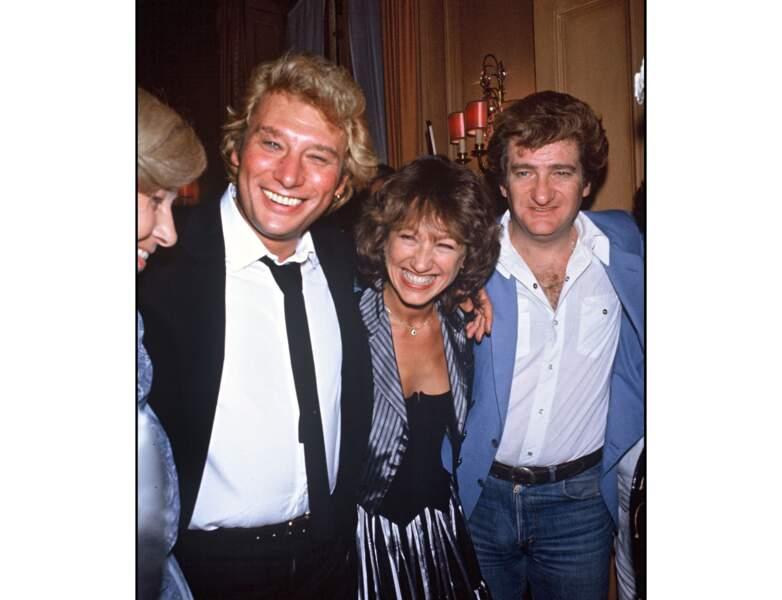 Toujours en 1982, elle pose entre Johnny Hallyday et Eddy Mitchell