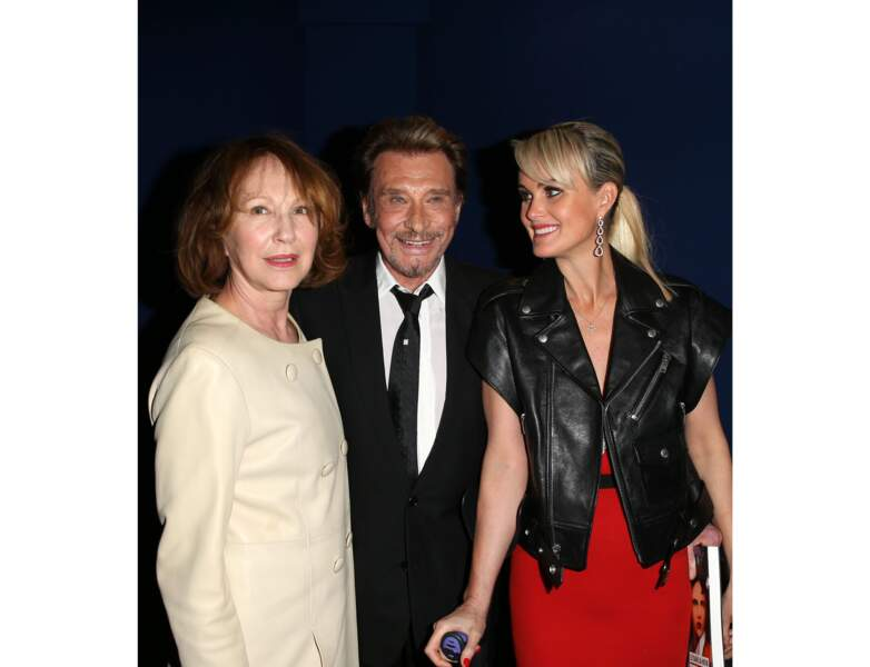 2014 : elle pose avec son ancien compagnon Johnny Hallyday et sa femme Laeticia