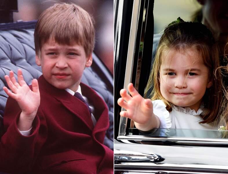 Le prince William et la princesse Charlotte saluent la foule.