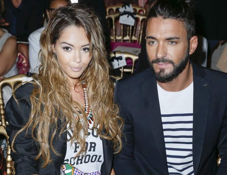 2014 : Le couple au défilé haute-couture de Jean Paul Gaultier. Nabilla a d'ailleurs déjà défilé pour le célèbre styliste.