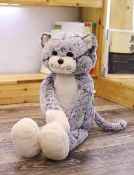 La peluche géante en forme de chat