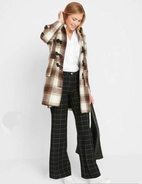 Les pantalons tendance de la rentrée automne-hiver 2020-2021: large avec des carreaux blancs et noirs