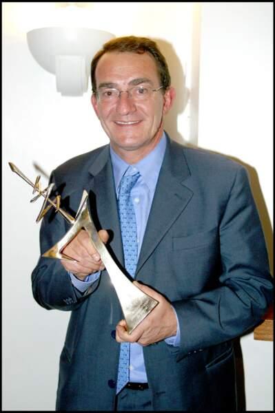 Le journaliste reçoit également le 7 d'Or du meilleur présentateur du JT, le 3 novembre 2003. Il en aura reçu 4 dans toute sa carrière.