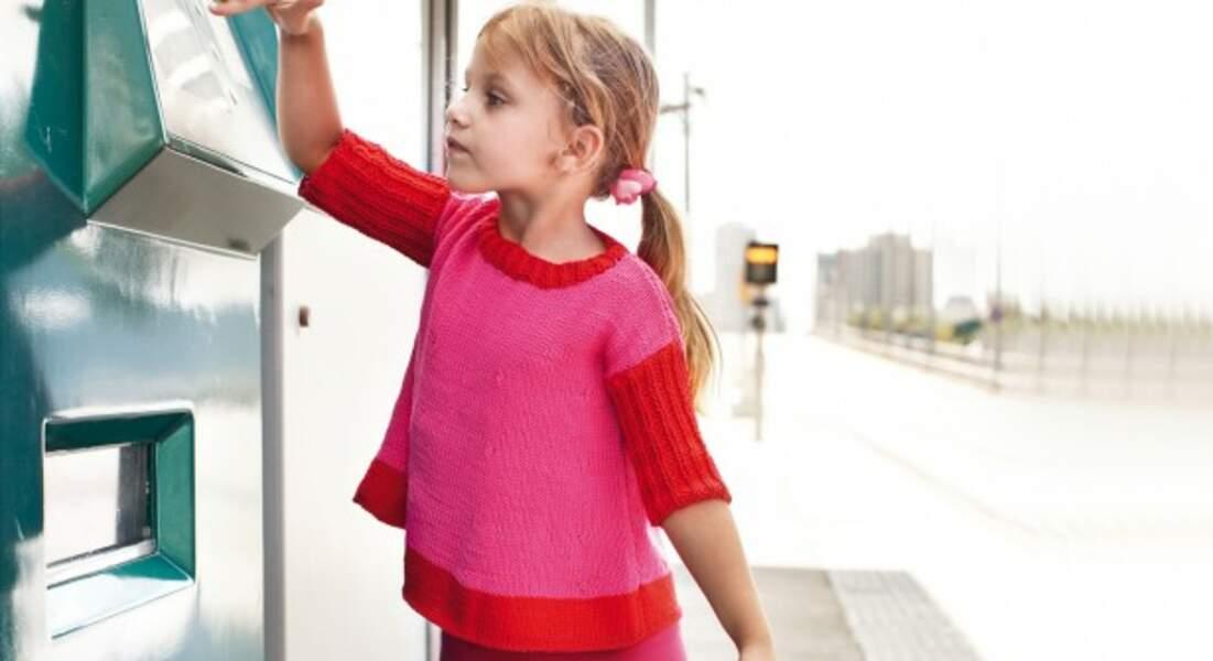 Un pull fuchsia pour enfant