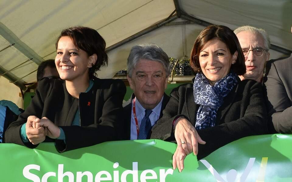 Najat Vallaud-Belkacem, nommée ministre des Droits des femmes, de la Ville, de la Jeunesse et des Sports dans le gouvernement de Manuel Valls, le 2 avril 2014, et Anne Hidalgo, maire de Paris, le jour du départ du marathon de Paris, deux jours après sa nomination.