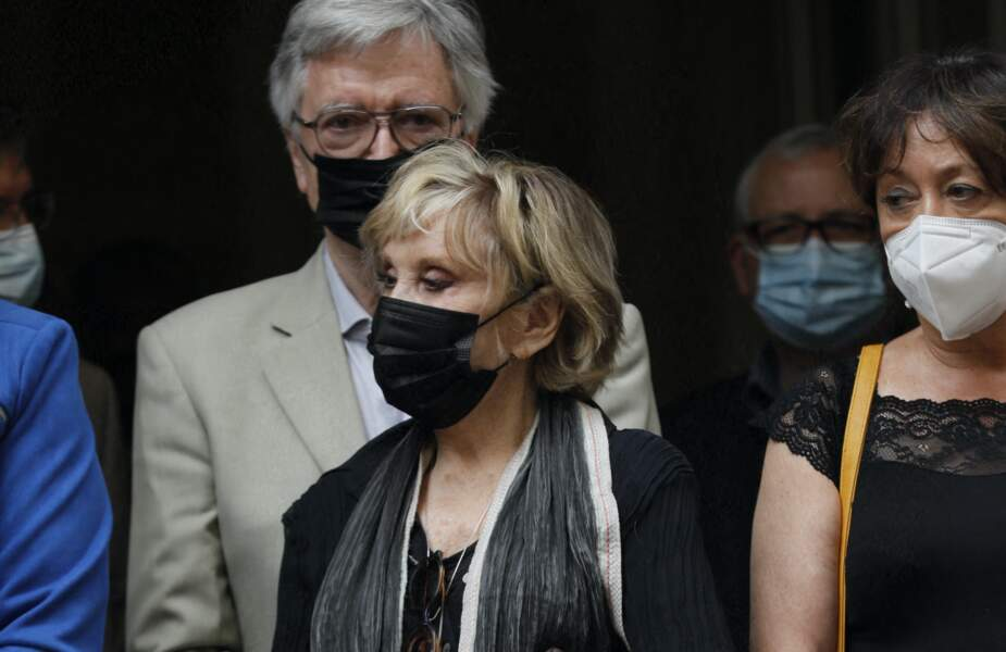 Sophie Darel et son mari Jack Anaclet à la sortie des obsèques de Jacqueline Caurat