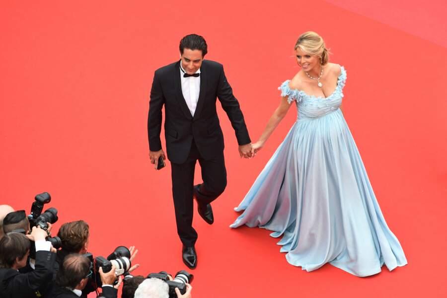 """Sylvie Tellier, enceinte, et son mari Laurent lors de la montée des marches du film """"Plaire, aimer et courir vite"""", lors du 71e Festival International du Film de Cannes, le 10 mai 2018."""
