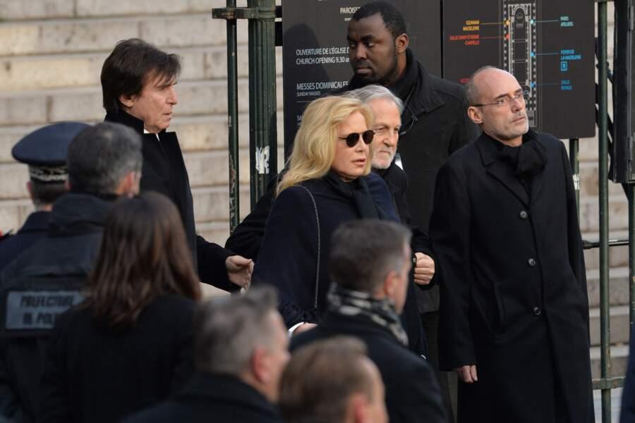 Sylvie Vartan et Tony Scotti à la sortie de l'église de la Madeleine, après les obsèques de Johnny Hallyday, à Paris, le 9 décembre 2017.